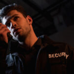 guard in uniform using walkie-talkie